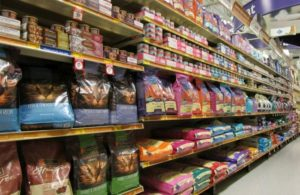 An aisle of different wet and dry cat food