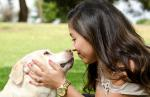 hispanic-woman-kissing-dog
