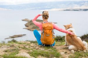woman-backpacking-with-dog