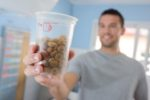 man-dry-dog-food-cup
