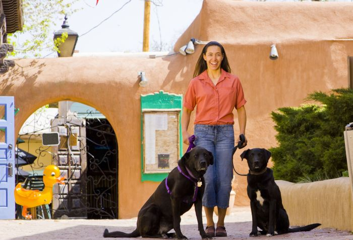 Latina-woman-dog-adobe-mexico