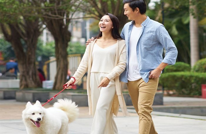 Chinese-woman-man-with-dog-in-park