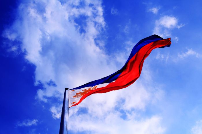 202009 philippine flag against blue sky