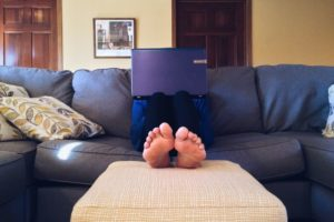 Person on couch with laptop