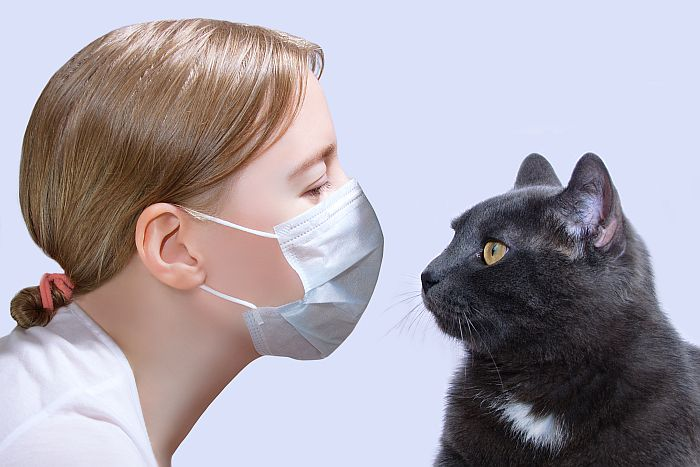 White-woman-black-cat-face-to-face-mask-covid-safety