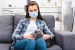 woman-face-mask-gray-cat-COVID-coronavirus-pandemic.jpg
